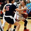 NOC Enid's Macie Jo Pierce smiles as she looks for an outlet while double teamed by Seminole State's Kinsey Callen and Pamela Grover Monday February 11, 2019 at the NOC Mabee Center. (Billy Hefton / Enid News & Eagle)