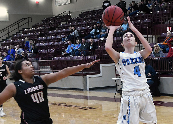 Okeene's Rachyl Wilson puts up a shot against Lookeba-Sickles' Kelsi Cox during an elimination game in a class B regional tournament Friday Feb. 15, 2019 at Pioneer High School. (Billy Hefton / Enid News & Eagle)