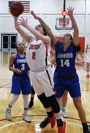 NOC Enid's Jacie Engler puts up a shot against Murray State's AndressaNascimento Tuesday Feb. 21, 2019 at the NOC Mabee Center. (Billy Hefton / Enid News & Eagle)