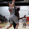 NOC Enid's Jackson Price tries to score over Seminole State's DeAngelo Adkins Monday February 11, 2019 at the NOC Mabee Center. (Billy Hefton / Enid News & Eagle)