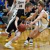 Drummond's Garrett dribbles upcort against Oklahoma Bible Academy's Garret Salyer during an elimination game in the regional tournament Thursday February 14, 2019 at Oklahoma Bible Academy. (Billy Hefton / Enid News & Eagle)