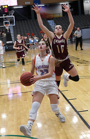 Chisholm's Briley Yunker goes in for a layup as Cashion's Kaitin Taylor tries to defend from behind during the Enid Downtown Basketball Festival February 1, 2019 at the Central National Bank Center. (Billy Hefton / Enid News & Eagle)