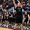 Players on the Pioneer bench rise to their feet as Payton Wingo shoots a three point shot against Pawnee during an elimination game in a class 2A regional tournament Saturday Feb. 23, 2019 at Pioneer High School. (Billy Hefton / Enid News & Eagle)