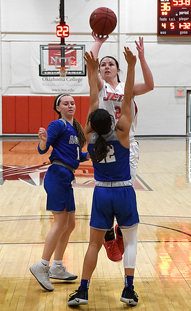 NOC Enid's Jacie Engler shoots over Murray State's Aaliyah Endsley Tuesday Feb. 21, 2019 at the NOC Mabee Center. (Billy Hefton / Enid News & Eagle)
