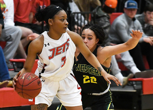 NOC Enid's Monique Tramble dribbles against pressure from Western Oklahoma's Marquetta Jackson-Rogers Monday February 4, 2019 at the NOC Mabee Center. (Billy Hefton / Enid news & Eagle)