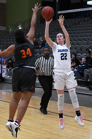 Enid's Catyi Moeller shoots over Putnam City's Iyonna Davis Tuesday February 12, 2019 at the Central National Bank Center. (Billy Hefton / Enid News & Eagle)