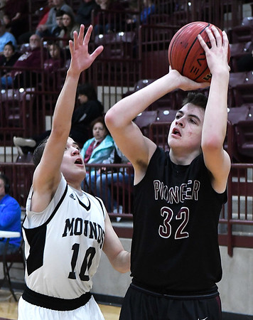 Pioneer's Kolby Vestal shoots while defended by Mounds' Devin Stockstill during an elimination game in a class 2A regional tournament Friday Feb. 22, 2019 at Pioneer High School. (Billy Hefton / Enid News & Eagle)