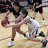 Pawnee's Erin Faw Faw goes after a loose ball with Pawnee's Sara Llamas-howell during an elimination game in the class 2A regional tournament Friday Feb. 22, 2019 at Pioneer High School. (Billy Hefton / Enid News & Eagle)