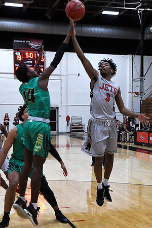 NOC Enid's Romio Harvey puts up a shot against Western Oklahoma's Chamar Dumas Monday February 4, 2019 at the NOC Mabee Center. (Billy Hefton / Enid news & Eagle)