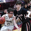 Timberlake's Cade Redding tries to drive against Lookeba-Sickles' Quinton Garner during the regional tournament Thursday February 14, 2019 at Pioneer High School. (Billy Hefton / Enid News & Eagle)