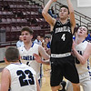 Timberlake's Devon Kent puts up a shot while surrounded by Lomega's Noah Snowden, Brock Mowery and Riley Lumpkin during an elimination game in a class B regional tournament Friday Feb. 15, 2019 at Pioneer High School. (Billy Hefton / Enid News & Eagle)