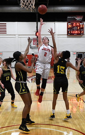 NOC Enid's Jacie Engler puts up a shot over Western Oklahoma's Alexis Young and Chiwna Johnson Monday February 4, 2019 at the NOC Mabee Center. (Billy Hefton / Enid news & Eagle)
