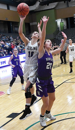 Seiling's Macy Kiya Whetstone shoots over Hydro-Eakly's Kyla Brooks during the class A area 1 championship game Friday Feb.22, 2019 at the Central National Bank Center. (Billy Hefton / Enid News & Eagle)