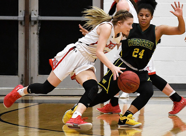 NOC Enid's Kaylee Hurst drives towards the basket against Western Oklahoma's Paradize Jackson Monday February 4, 2019 at the NOC Mabee Center. (Billy Hefton / Enid news & Eagle)