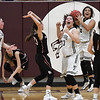 Timberlake's Caitlyn Fargo (4), Samantha Phillips (13) and Maegan Scobey (2) begin to celebrate as time expires in their 51-49 win over Lookeba-Sickles in the regional tournament Thursday February 14, 2019 at Pioneer High School. (Billy Hefton / Enid News & Eagle)