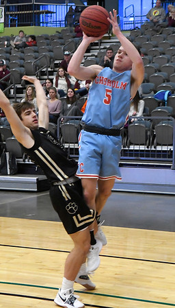 Chisholm's Kolten Childers puts up a shot against Cashion's Jonah Jenkins during the Enid Downtown Basketball Festival February 1, 2019 at the Central National Bank Center. (Billy Hefton / Enid News & Eagle)