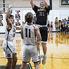 Drummond's Brandon Coontz shoots over Oklahoma Bible Academy's Garret Salyer during an elimination game in the regional tournament Thursday February 14, 2019 at Oklahoma Bible Academy. (Billy Hefton / Enid News & Eagle)