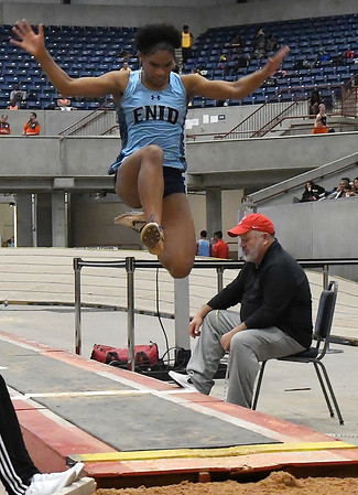 Enid's D'Sani Levy competes in the long jump Friday February 1, 2019 at the Chisholm Trail Expo Center. (Billy Hefton / Enid News & Eagle)