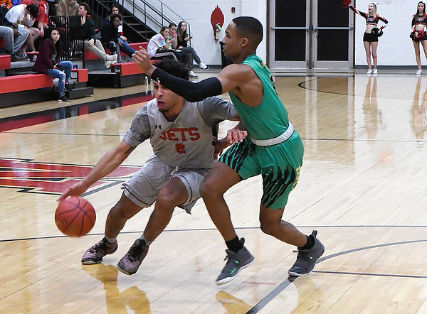 NOC Enid's Questyn Luckey drives towards the basket against Western Oklahoma's Lavorris Givins Monday February 4, 2019 at the NOC Mabee Center. (Billy Hefton / Enid news & Eagle)