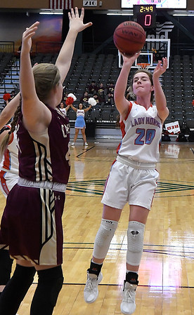 Chisholm's Danae Stidham shoots over Cashion's Brook Shelly during the Enid Downtown Basketball Festival February 1, 2019 at the Central National Bank Center. (Billy Hefton / Enid News & Eagle)