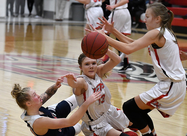 NOC Enid's Macie Jo Pierce and Kaylee Hurst scramble for a loose ball with Seminole State's Kinsey Callen Monday February 11, 2019 at the NOC Mabee Center. (Billy Hefton / Enid News & Eagle)