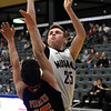 Pioneer's Payton Wingo shoots over Preston's Turner Howk during a Class 2A Area I elemination game Thursday February 28, 2019 at the Central National Bank Center. (Billy Hefton / Enid News & Eagle)