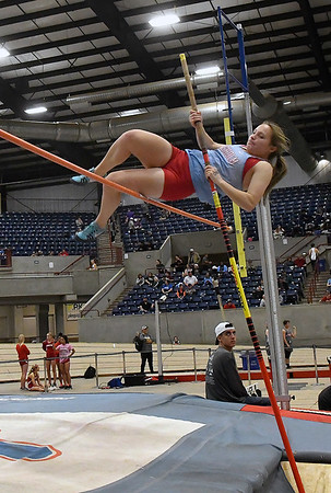 Chisholm's Danielle Dick clears the bar in the pole vault at the Chisholm Trail Expo Center Saturday February 2, 2018. (Billy Hefton / Enid News & Eagle)