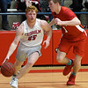 Chisholm's T.C. Smith drives towards the basket against Prague's Brady Thorpe during the Longhorn's 53-50 overtime win in a class 3A regional tournament Thursday Feb. 21, 2019 at Chisholm High School. (Billy Hefton / Enid News & Eagle)