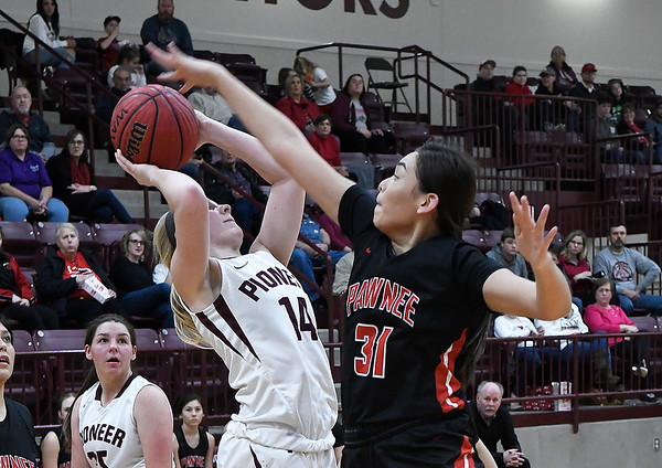 Pawnee's Kennedy Cassody puts up a contested shot against Pawnee's Skidi Leading Fox during an elimination game in the class 2A regional tournament Friday Feb. 22, 2019 at Pioneer High School. (Billy Hefton / Enid News & Eagle)