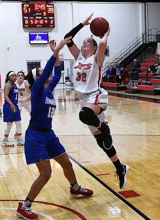 NOC Enid's Sarah Griswold goes up against Murray State's Madalyn Jessepe Tuesday Feb. 21, 2019 at the NOC Mabee Center. (Billy Hefton / Enid News & Eagle)
