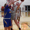 NOC Enid's Lauren Wade puts up a shot against NEO's Eliska Stebetakova Monday, February 10, 2020 at the NOC Mabee Center. (Billy Hefton / Enid News & Eagle)