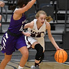 Garber's Alyssa Johnson is pressured by Hydro-Eakly's Raegan Klaassen as she dribble upcourt during the championship game of the Area 1 tournament Friday, February 28, 2020 at the Stride Bank Center. (Billy Hefton / Enid News & Eagle)