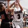 Garber's Kathryn Plunkett is hit by OBA's Clara Caldwell during the district championship game Saturday, February 15, 2020 at Garber High School. (Billy Hefton / Enid News & Eagle)