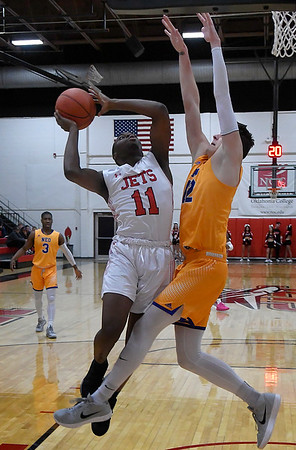 NOC Enid's Ikenna Okeke goes up against NEO's Nikita Konstantynovskyi Monday, February 10, 2020 at the NOC Mabee Center. (Billy Hefton / Enid News & Eagle)