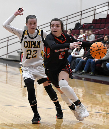 OBA's Devan Hawk drives pass Copan's Sara Gilliland during the district tournament at Garber High School Friday, February 14, 2020. (Billy Hefton / Enid News & Eagle)