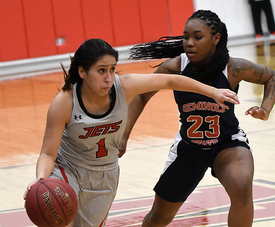 NOC Enid's Shelby Black drives towards the basket against Seminole's Sierra Gordon Monday, February 3, 2020 at the NOC Mabee Center. (Billy Hefton / Enid news & Eagle)