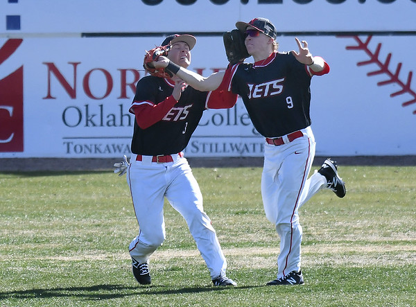 NOC Enid's Gage Ninness and Merek Hawthrone collide in the outfield against NE Nebraska Saturday, February 1, 2020 at David Allen Memorial Ballpark. (Billy Hefton / Enid News & Eagle)