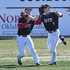 NOC Enid's Gage Ninness and Merek Hawthrone collide in the outfield against NE Nebraska Saturday, February 1, 2020 at David Allen Memorial Ballpark. (Billy Hefton / Enid News & Eagle)