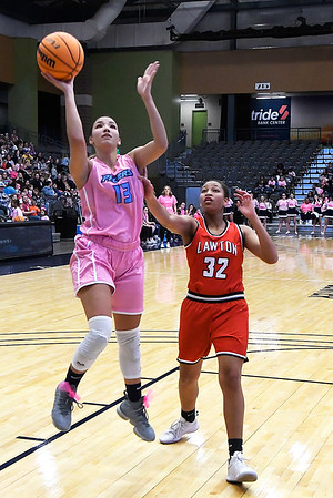 Enid's Lanie Goins gets by Lawton's Nina Perry for a basket Saturday February 8, 2020 at the Stride Bank Center. (Billy Hefton / Enid News & Eagle)