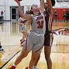 NOC Enid's Madelyn Hankins fends off Redlands' Christina Jenkins as she drives to the basket Thursday, February 20, 2020 at the NOC Mabee Center. (Billy Hefton / Enid news & Eagle)