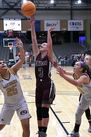 Garber's Katyryn Plunkett shoots over Laverne's Nany Echevarria during the consolation championship game of the Area 1 tournament Saturday, February 29, 2020 at the Stride Bank Center. (Billy Hefton / Enid News & Eagle)