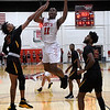 NOC Enid's Ikenna Okeke goes up in the lane against Redlands' Antonio Lyons and Mark Lamb Thursday, February 20, 2020 at the NOC Mabee Center. (Billy Hefton / Enid news & Eagle)