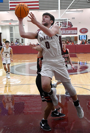 Garber's Sha Martin goes to the basket against OBA during the district championship game Saturday, February 15, 2020 at Garber High School. (Billy Hefton / Enid News & Eagle)
