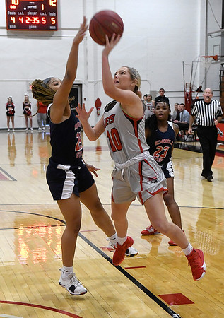 NOC Enid's Hayden Freeman puts up a shot against Seminole's Kamiyah Lyons Monday, February 3, 2020 at the NOC Mabee Center. (Billy Hefton / Enid news & Eagle)