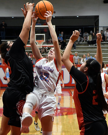 Chisholm's Alice Watkins tries to grab a rebound away from Riverside's Glyddia Domebo during a district tournament game at Chisholm High School Saturday, February 22, 2020. (Billy Hefton / Enid News & Eagle)
