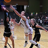 OBA's Devan Hawk gets off a shot against Watonga's Karra Blackbear and Landri Hussey during the Downtown Basketball Festival Saturday, February 1, 2020 at the Stride Bank Center. (Billy Hefton / Enid News & Eagle)