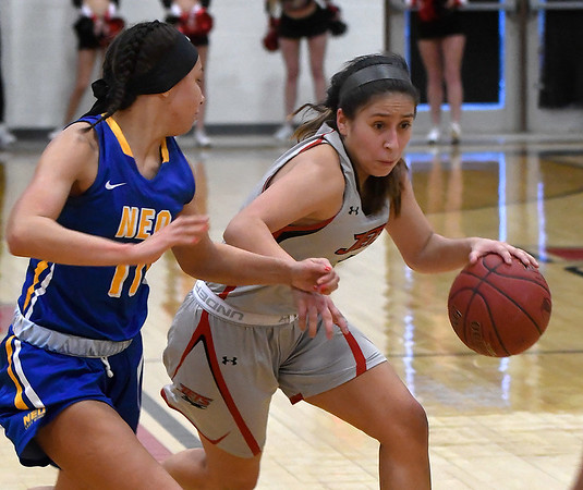 NOC Enid's Shelby Black drives towards the basket against NEO's Kiarra Brooks Monday, February 10, 2020 at the NOC Mabee Center. (Billy Hefton / Enid News & Eagle)