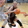 Garber's Alyssa Johnson drives pass Laverne's Maddie Long during the consolation championship game of the Area 1 tournament Saturday, February 29, 2020 at the Stride Bank Center. (Billy Hefton / Enid News & Eagle)