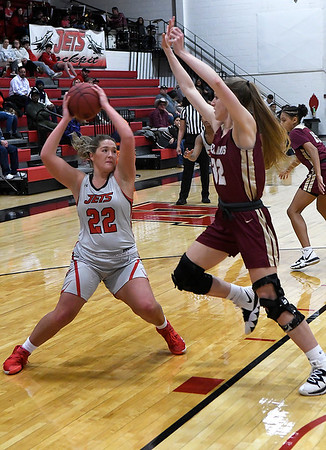 NOC Enid's Taelor Parker gives a ball fake to Redlands' Grace Warner Thursday, February 20, 2020 at the NOC Mabee Center. (Billy Hefton / Enid news & Eagle)