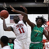 NOC Enid's Ikenna Okeke goes up against Western's Ji'wen Taylor Thursday, February 27, 2020 at the NOC Mabee Center. (Billy Hefton / Enid News & Eagle)